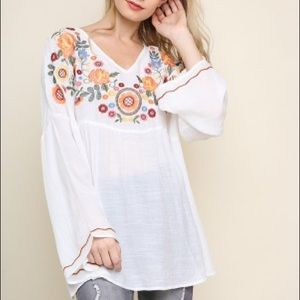 Cool grey embroidered top